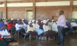 Trinity staff lead a sensitisation meeting