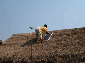 Installing a solar panel on top of a thatched roof