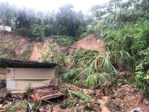 houses damaged by mud slides
