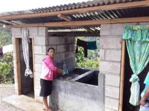 Senora Delmira S. at the latrine and wash station