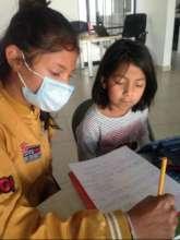 Ximena helping Lluvia with her english homework
