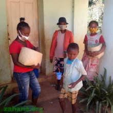 Teacher and cooks distributing mofo gasy