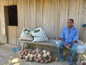 Farmer Jose with lemons and coconuts for market