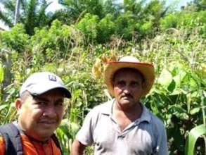 Victor Daniel, the author, with a farmer
