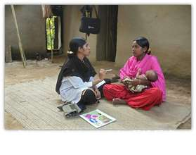 Shiuly with a BRAC health worker