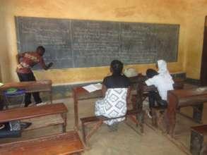 Mwalimu Dibeit teaching at Study Camp