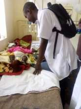 Dibeit visits a child in the pediatric ward
