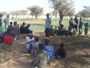 Families take a break from working in the field