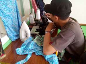 A student learning using sewing machine