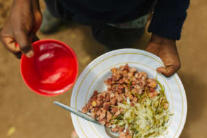 Githeri (boiled maize and beans) and cabbage