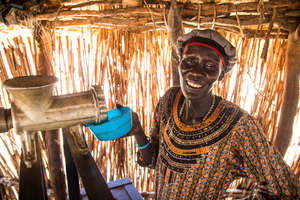 Using a groundnut machine in South Sudan.