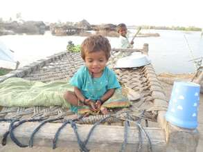 Flood Affected child waiting for help