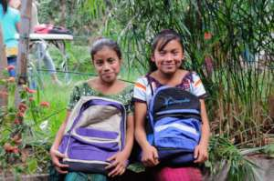 Students with their new backpacks