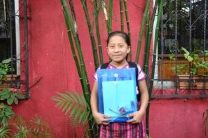 Sponsored student Juana receives her new backpack